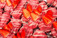 Eat sweet dessert cuisine Homemade Close-up french cake eclairs or profiteroles with custard Red Pink, chocolate and strawberries stock photo