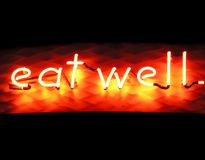 Eat Well. Neon sign Stock Image