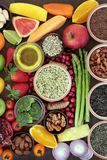 Eat Well for Good Health. Health and super food concept to promote fitness and a healthy heart with fruit, vegetables, nuts, seeds, grains an pulses. Foods high Stock Photo