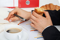 Eat at work Royalty Free Stock Photos
