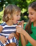 Eat yogurt Stock Photography