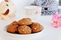 Eatable almond & chocolate chip cookies with coffee. Royalty Free Stock Images