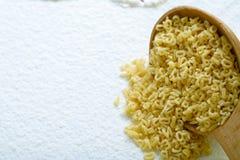 Eatable alphabet on flour Stock Photos
