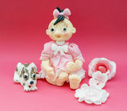 Eatable decorative doll and dog of marchpane Stock Photos