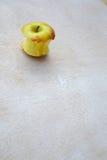 An eaten apple Stock Photos