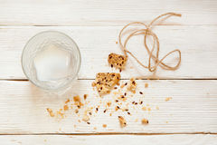 Eaten biscuits and drunk milk with lumps on a white wooden backg. Round. Top view. Cooking concept. Concept of healthy food. Homemade Royalty Free Stock Photos