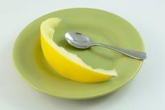 Eaten Golden honeydew slice Royalty Free Stock Photography