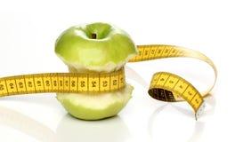 Eaten green apple Royalty Free Stock Image