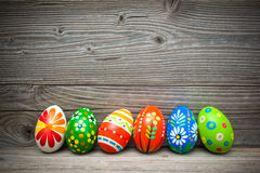 Eater eggs on old wooden background. With copy space for your message Royalty Free Stock Image