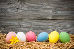 Eater eggs on old wooden background. With copy space for your message Royalty Free Stock Photography