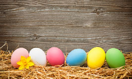 Eater eggs on old wooden background. With copy space for your message Royalty Free Stock Photo