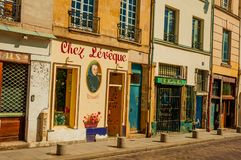 "Eatery facade decorated with paintings in Paris. Paris, France - July 08, 2017. Eatery facade decorated with paintings in Paris. Known as the ""City of Light Royalty Free Stock Images"