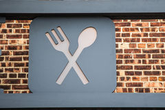Eatery sign. A sign with crossed spoon and fork Royalty Free Stock Image