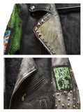 eather地下低劣的时髦的夹克的宏观零件有铆钉的和有在后面的废物不死的口号的。 免版税库存图片