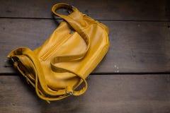 Eather school bag. On desk royalty free stock photo