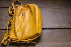 Eather school bag. On desk royalty free stock image
