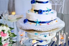 Wedding cake with bouquet and stemware Stock Image