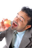 Eating. Break time in the work to eat an apple Royalty Free Stock Photos