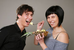 Eating ananas Stock Photos