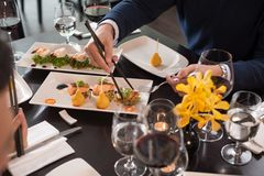 Eating appetizers Stock Images
