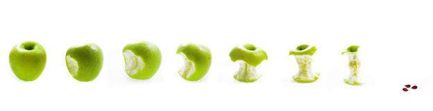 Eating apple. Eating green apple on white background  to end Stock Image