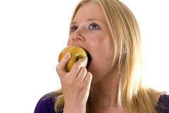 Eating an apple royalty free stock images