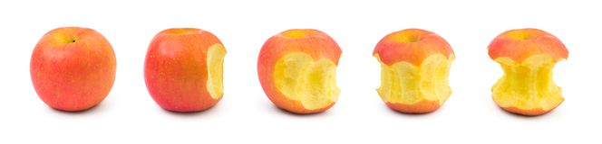 Eating apple. Fruit isolated on white background royalty free stock photos