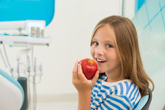 Eating apple Stock Image
