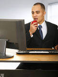 Eating Apple In Office Stock Photography