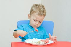 Eating baby Royalty Free Stock Image