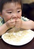 Eating baby. To grab pasta Royalty Free Stock Photos