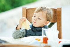 Eating baby Royalty Free Stock Photography
