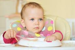 Eating baby Stock Photos