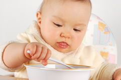 Eating baby Royalty Free Stock Images