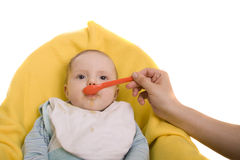 Eating baby. On a white background Stock Photos
