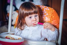 Eating baby girl Stock Photo