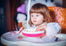 Eating baby girl Stock Image