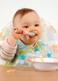 Eating baby girl Stock Photos