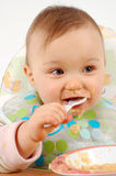 Eating baby girl Royalty Free Stock Photography