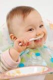 Eating baby girl Stock Photography