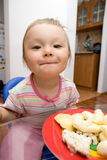 Eating baby girl Stock Images