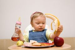 Eating baby girl royalty free stock photos
