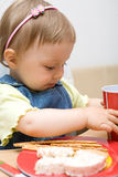 Eating baby girl Royalty Free Stock Images