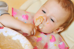 Eating baby Stock Images