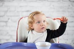 Eating baby girl. At home Royalty Free Stock Photos