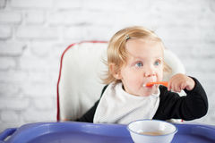 Eating baby girl. At home Stock Photos