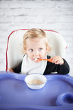 Eating baby girl. At home Royalty Free Stock Image