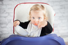 Eating baby girl. At home Stock Photography