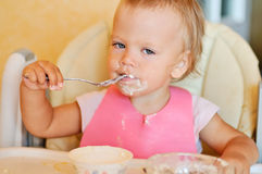 Eating baby girl Royalty Free Stock Photo