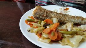 Eating of baked cod with vegetables stock video
